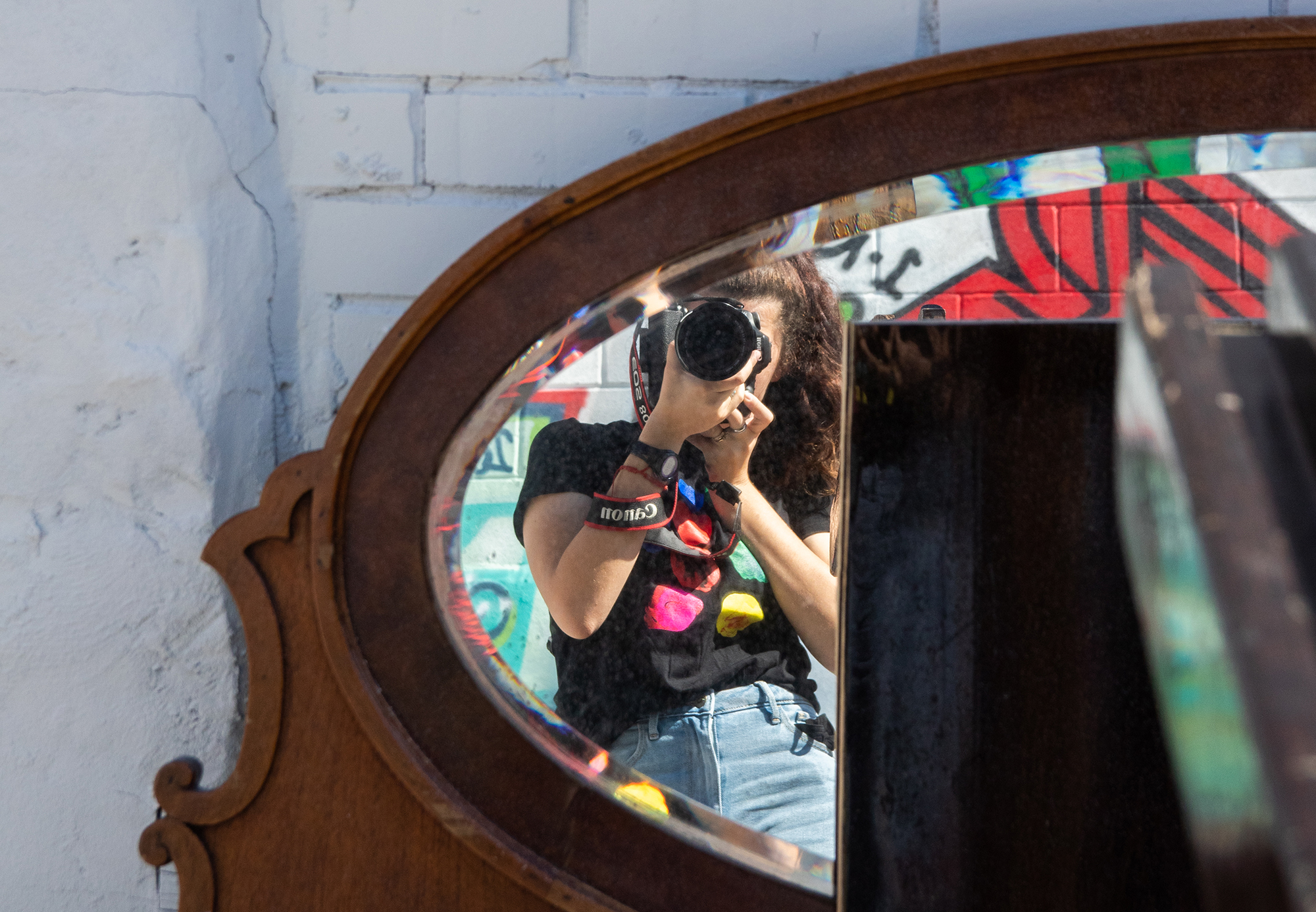 A person photographing themselves in a mirror